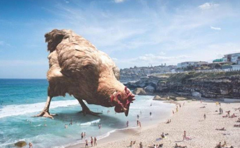 Painting of a giant chicken pecking at food on a beach covered with tiny people